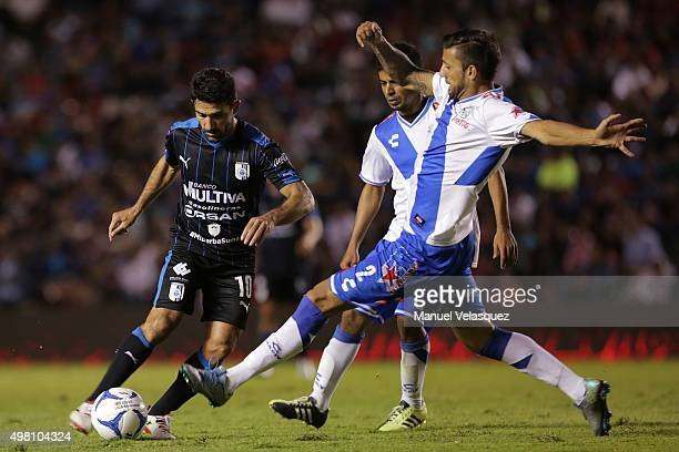 Antonio Naelson of Queretaro struggles for the ball with Robert Herrera of Puebla during the 17th round match between Queretaro and Puebla as part of...