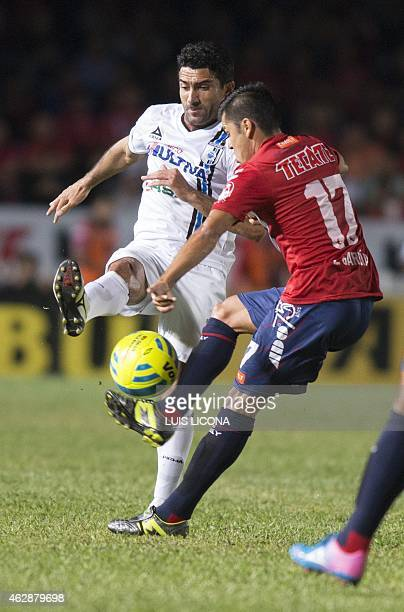 Antonio Naelson of Queretaro vies for the ball with Emmanuel Garcia of Veracruz during their Mexican Clausura tournament football match at the Luis...