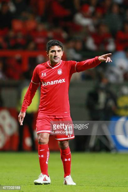 Antonio Naelson of Toluca points during a match between Toluca and Puebla as part of the 10th round Clausura 2014 Liga MX at Nemesio Diez Stadium on...