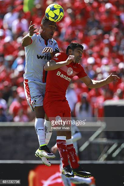 Antonio Naelson of Toluca struggles for the ball with Rodolfo Salinas of Atlas during the 1st round match between Toluca and Atlas as part of the...