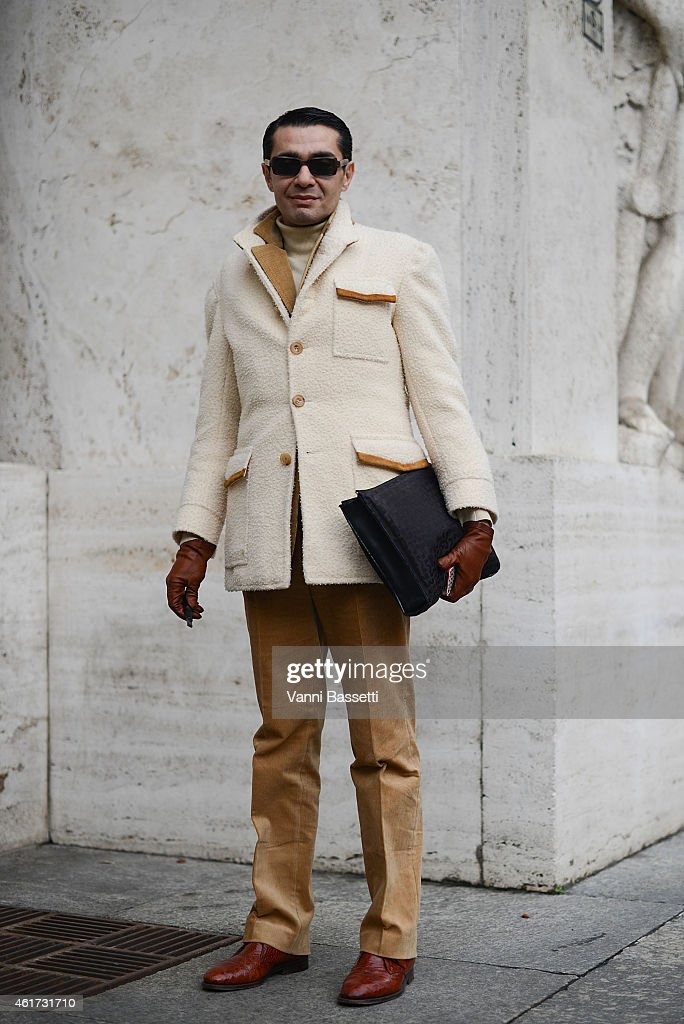 Antonio Nieto poses wearing a Ciffonelli coat and Hackett pants during day 2 of Milan Menswear Fashion Week Fall/Winter 2015/2016 on January 18, 2015 in Milan, Italy.