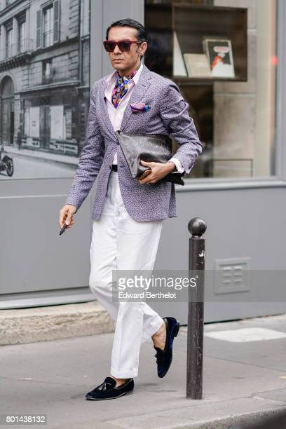 Antonio Nieto wears a blazer jacket white pants outside the Thom Browne show during Paris Fashion Week Menswear Spring/Summer 2018 on June 25 2017 in...