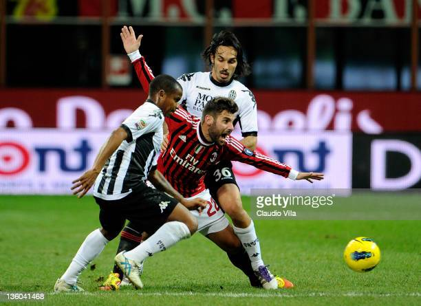 Antonio Nocerino of AC Milan and Francesco Bolzoni of AC Siena compete for the ball during the Serie A match between AC Milan and AC Siena at Stadio...