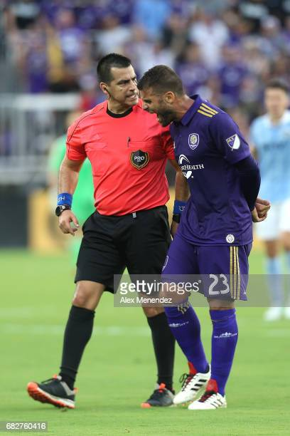 ORLANDO FL MAY 13 Antonio Nocerino of Orlando City SC argues a call with referee Ricardo Salazar during an MLS soccer match between Sporting Kansas...