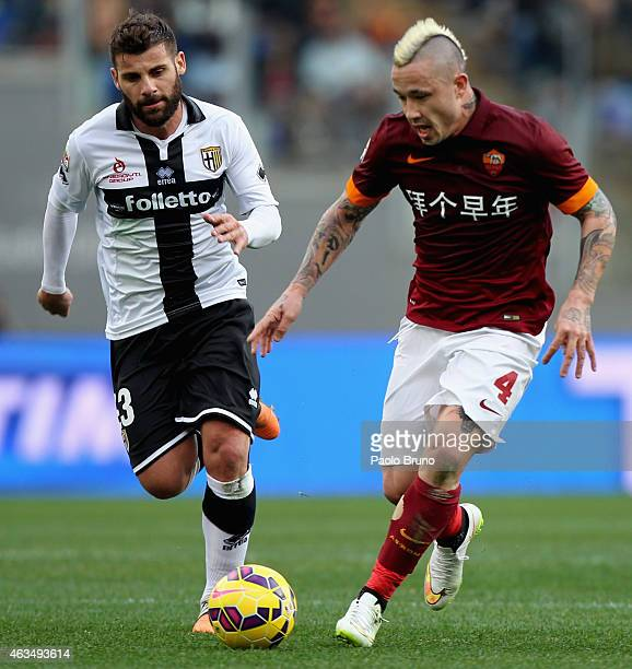Antonio Nocerino of Parma FC competes for the ball with Radja Nainggolan of AS Roma during the Serie A match between AS Roma and Parma FC at Stadio...