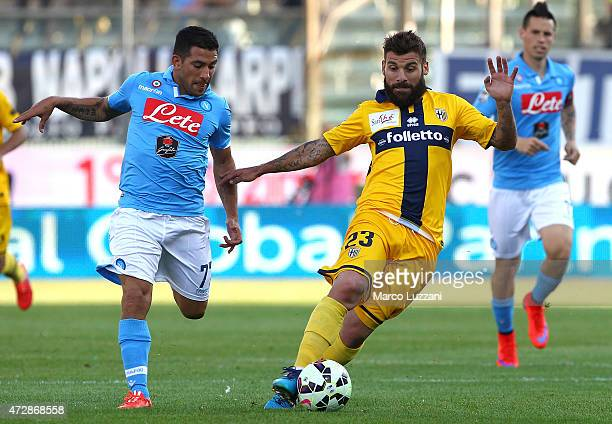 Antonio Nocerino of Parma FC competes for the ball with Walter Gargano of SSC Napoli during the Serie A match between Parma FC and SSC Napoli at...