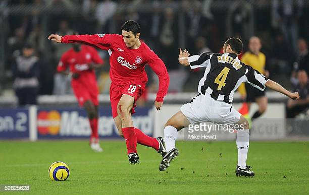 Antonio Nunez of Liverpool skips past the challenge of Paolo Montero of Juventus during the UEFA Champions League quarterfinal second leg between...