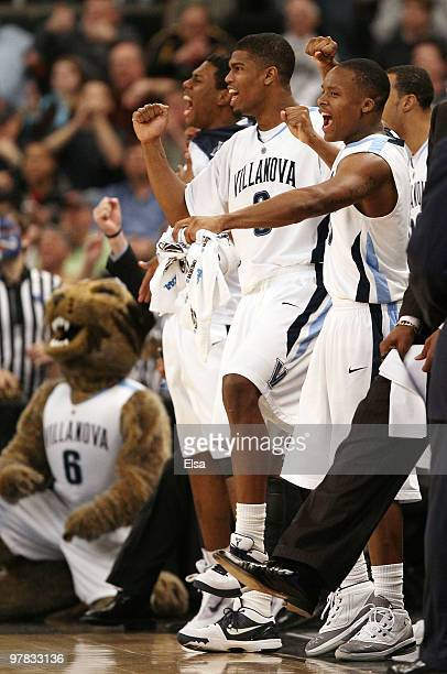 Antonio Pena and Maalik Wayns of the Villanova Wildcats celebrate in the second half against the Robert Morris Colonials during the first round of...