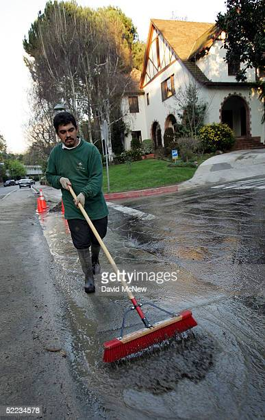 Antonio Pena of Hidalgo Mexico sweeps up in Chevy Chase Canyon as southern California gets a break from the rains of the wettest season in 113 years...