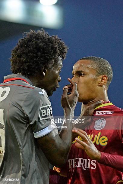 Antonio Pereira Dos Santos Kanu of Standard and Frederic Duplus of Zulte-Waregem dispute during the Jupiler League match between Zulte Waregem and...