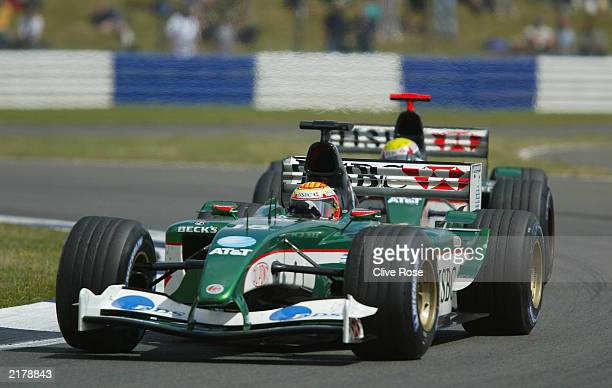 Antonio Pizzonia of Brazil and Jaguar leads team mate Mark Webber of Australia and Jaguar in action during the Formula One British Grand Prix at...