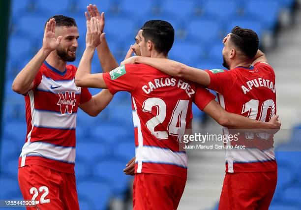 Antonio Puertas of Granada is congratulated after he scores the opening goal during the Liga match between Real Sociedad and Granada CF at Estadio...