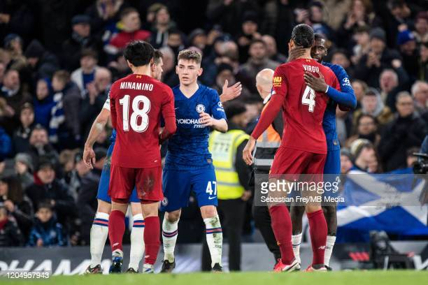 Antonio Rüdiger and Billy Gilmour of Chelsea and Takumi Minamino and Virgil van Dijk embrace after the FA Cup Fifth Round match between Chelsea FC...
