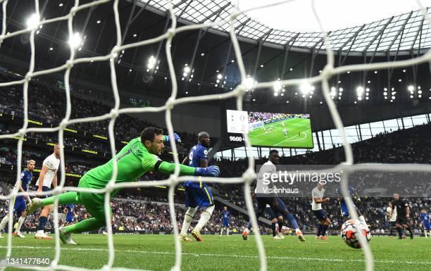 Antonio Rüdiger beats Tottenham goalkeeper Hugo Lloris to score Chelsea's third goal during the Premier League match between Tottenham Hotspur and...