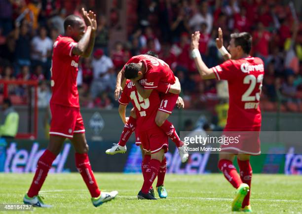 Antonio Rios of Toluca and his teammates celebrates after scoring the opening goal against Xolos de Tijuana during the Quarterfinal second leg match...