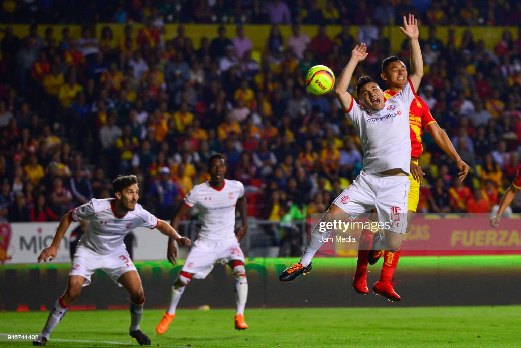 Antonio Rios (L) of Toluca and Miguel Sansores (R) of Morelia jump for the ball during the 15th round match between Morelia and Toluca as part of the Torneo Clausura 2018 Liga MX at Jose Maria Morelos Stadium on April 14, 2018 in Morelia, Mexico.