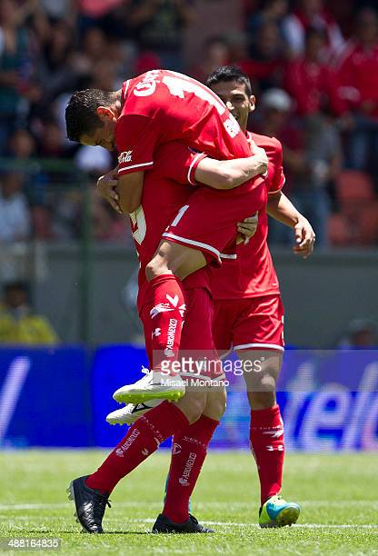 Antonio Rios of Toluca celebrates with his teammates after scoring the opening goal against Xolos de Tijuana during the Quarterfinal second leg match...