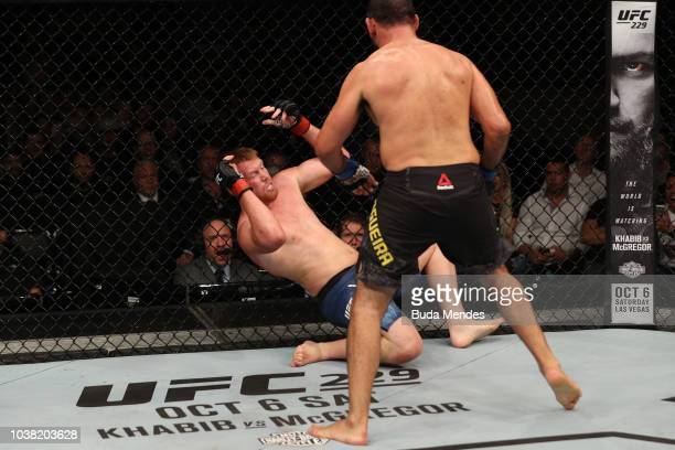 Antonio Rogerio Nogueira of Brazil punches Sam Alvey in their light heavyweight bout during the UFC Fight Night event at Ibirapuera Gymnasium on...