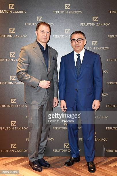 Antonio Rossi and Ferutdin Zakirov attend Ferutdin Zakirov Boutique Opening on May 19 2016 in Milan Italy