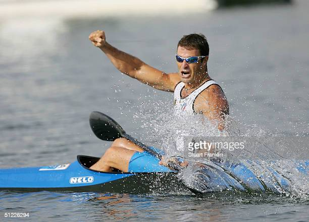 Antonio Rossi of Italy celebrates winning the silver medal with Beniamino Bonomi in the men's K2 class 1000 metre final on August 27 2004 during the...