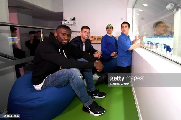Antonio Rudiger and Gary Cahill of Chelsea FC interacts with children during the Chelsea FC sensory room launch at Stamford Bridge on May 2 2018 in...