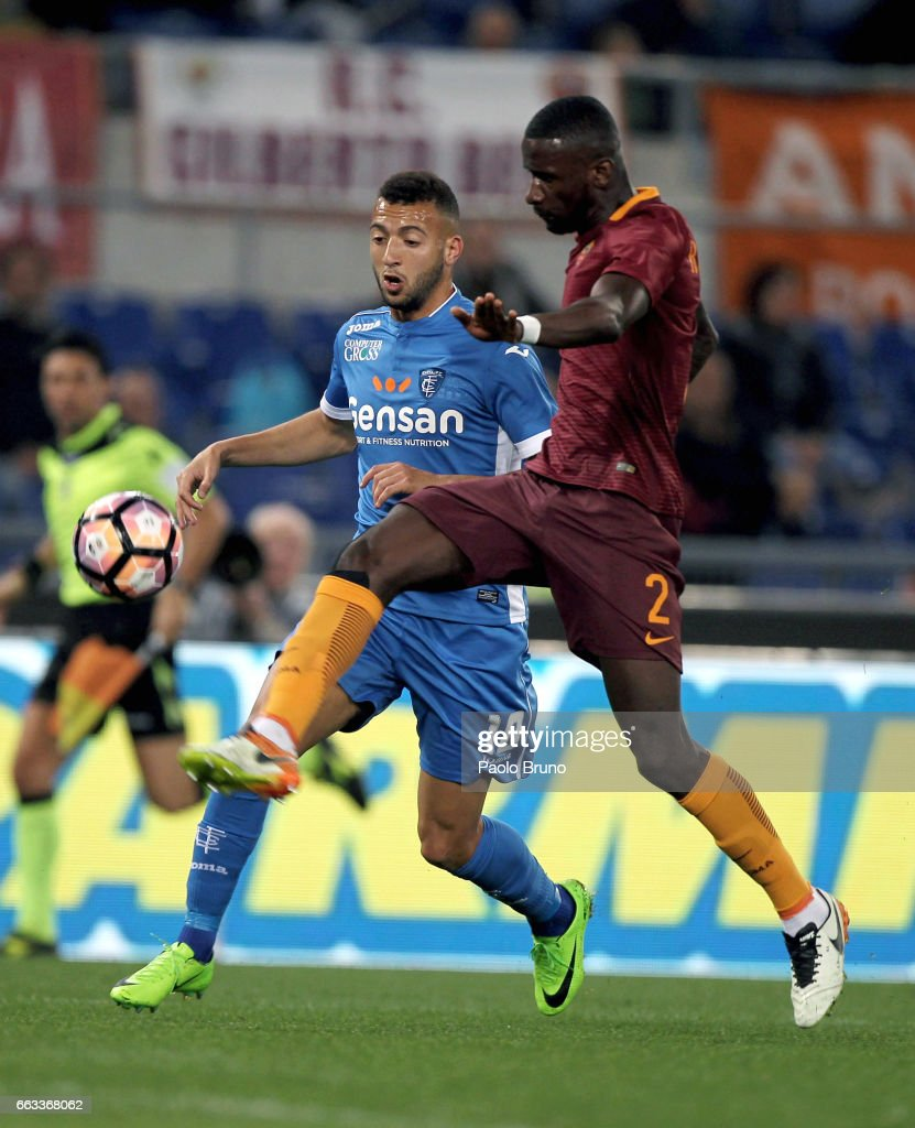 Antonio Rudiger (R) of AS Roma competes for the ball with Omar El Kaddouri of Empoli FC during the Serie A match between AS Roma and Empoli FC at Stadio Olimpico on April 1, 2017 in Rome, Italy.