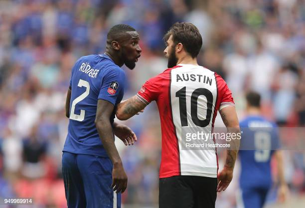 Antonio Rudiger of Chelsea and Charlie Austin of Southampton clash during The Emirates FA Cup Semi Final match between Chelsea and Southampton at...