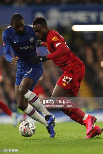 Antonio Rudiger of Chelsea and Divock Origi of Liverpool during the FA Cup Fifth Round match between Chelsea FC and Liverpool FC at Stamford Bridge...