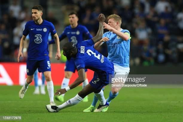 Antonio Rudiger of Chelsea and Kevin de Bruyne of Manchester City clash before both go down injured during the UEFA Champions League Final between...