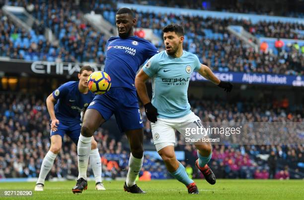 Antonio Rudiger of Chelsea and Sergio Aguero of Manchester City battle for the ball during the Premier League match between Manchester City and...
