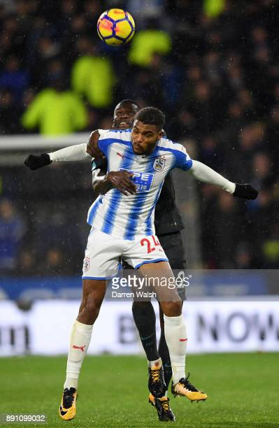Antonio Rudiger of Chelsea and Steve Mounie of Huddersfield Town compete for a header during the Premier League match between Huddersfield Town and...