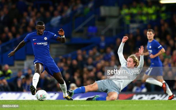 Antonio Rudiger of Chelsea and Tom Davies of Everton battle for possession during the Carabao Cup Fourth Round match between Chelsea and Everton at...