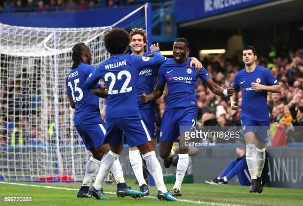 Antonio Rudiger of Chelsea celebrates scoring the first goal with team mates during the Premier League match between Chelsea and Stoke City at...
