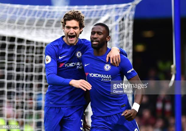 Antonio Rudiger of Chelsea celebrates scoring the first goal with team mate Marcos Alonso of Chelsea during the Premier League match between Chelsea...