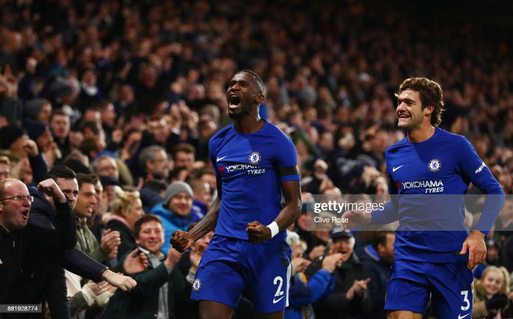 Antonio Rudiger of Chelsea celebrates with Marcos Alonso of Chelsea after scoring his sides first goal during the Premier League match between Chelsea and Swansea City at Stamford Bridge on November 29, 2017 in London, England.