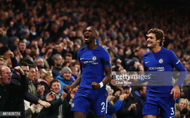 Antonio Rudiger of Chelsea celebrates with Marcos Alonso of Chelsea after scoring his sides first goal during the Premier League match between...