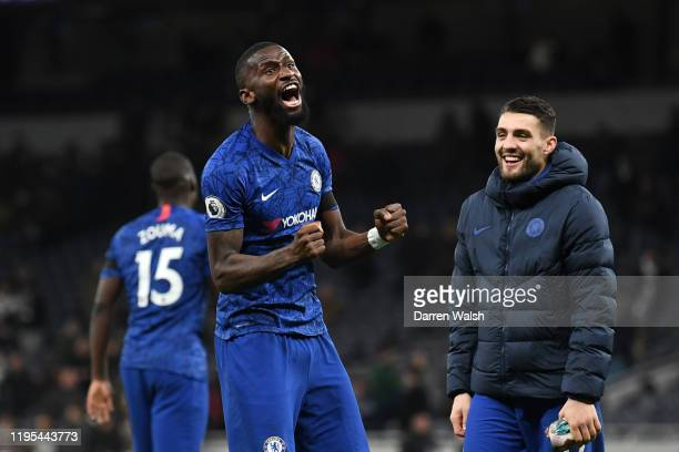Antonio Rudiger of Chelsea celebrates with Mateo Kovacic of Chelsea following their sides victory in the Premier League match between Tottenham...