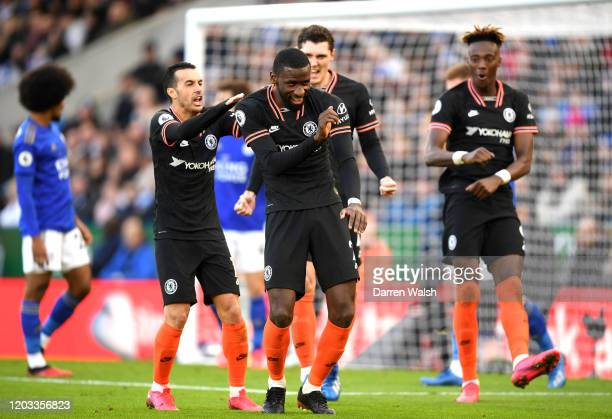 Antonio Rudiger of Chelsea celebrates with Pedro and Tammy Abraham after scoring his team's first goal during the Premier League match between...