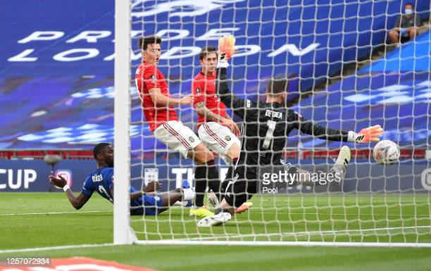 Antonio Rudiger of Chelsea challenges for the ball and Harry Maguire of Manchester United scores an own goal to lead to Chelsea third goal during the...