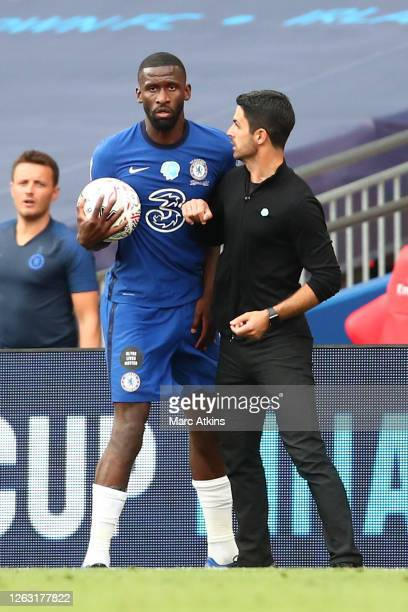 Antonio Rudiger of Chelsea confronts Mikel Arteta Manager of Arsenal during the FA Cup Final match between Arsenal and Chelsea at Wembley Stadium on...