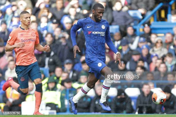 Antonio Rudiger of Chelsea in action while being pressured by Richarlison of Everton during the Premier League match between Chelsea and Everton at...