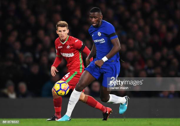 Antonio Rudiger of Chelsea is put under pressure from Tom Carroll of Swansea City during the Premier League match between Chelsea and Swansea City at...