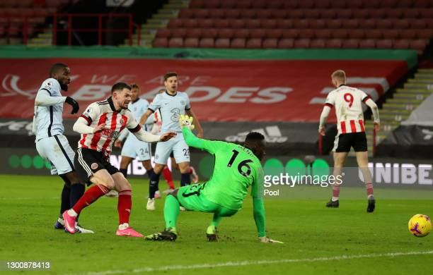 Antonio Rudiger of Chelsea scores an own goal past team mate Edouard Mendy for Sheffield United's first goal during the Premier League match between...