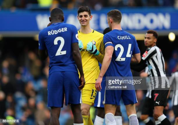 Antonio Rudiger of Chelsea Thibaut Courtois of Chelsea and Gary Cahill of Chelsea celebrates victory after the Premier League match between Chelsea...