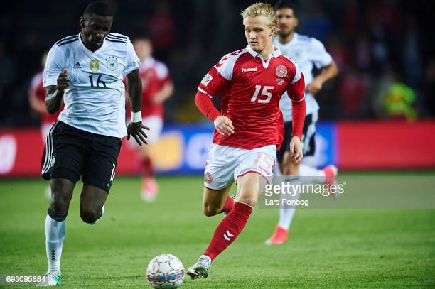 Antonio Rudiger of Germany and Kasper Dolberg of Denmark compete for the ball during the international friendly match between Denmark and Germany at...