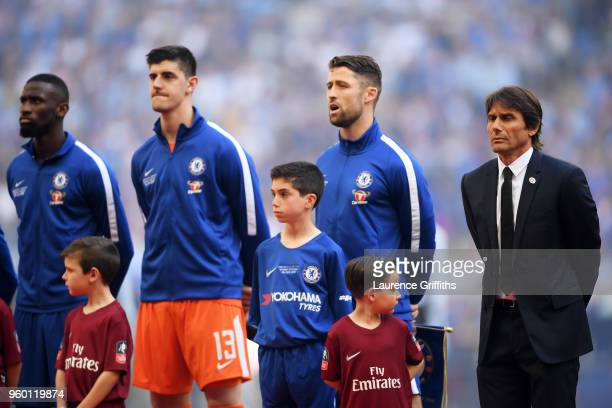 Antonio Rudiger Thibaut Courtois Gary Cahill and Antonio Conte Manager of Chelsea sing the national anthem ahead of The Emirates FA Cup Final between...