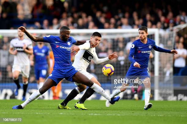 Antonio Ruediger and Jorginho of Chelsea battle for possession with Aleksandar Mitrovic of Fulham during the Premier League match between Chelsea FC...