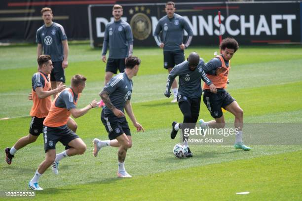 Antonio Ruediger and Leroy Sane in action during Day 8 of the Germany training camp ahead of the UEFA EURO 2020 on June 04, 2021 in Seefeld in Tirol,...