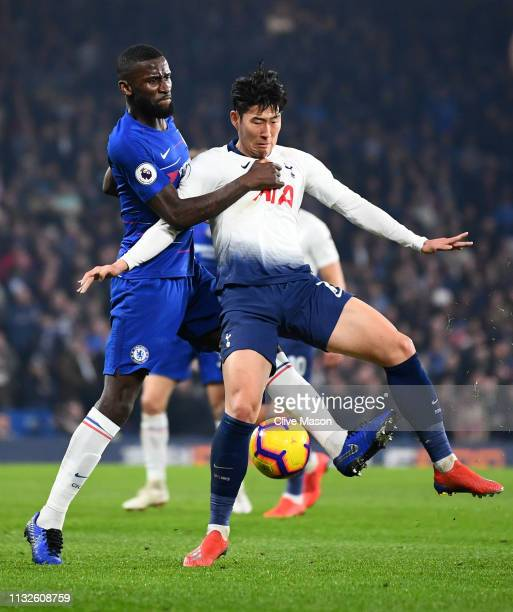 Antonio Ruediger of Chelsea battles for possession with HeungMin Son of Tottenham Hotspur during the Premier League match between Chelsea FC and...