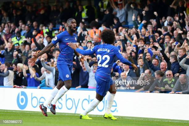 Antonio Ruediger of Chelsea celebrates after scoring his team's first goal with Willian of Chelsea during the Premier League match between Chelsea FC...